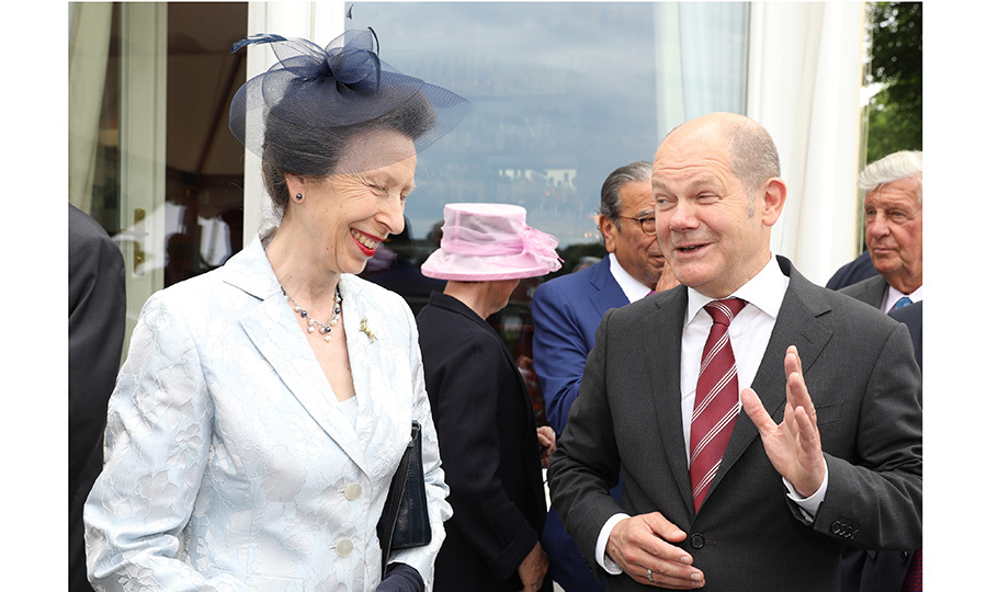 Queen Elizabeth's daughter Princess Anne shared a laugh with  Hamburg's mayor Olaf Scholz during a visit to Germany to help celebrate the British monarch's 91st birthday. 