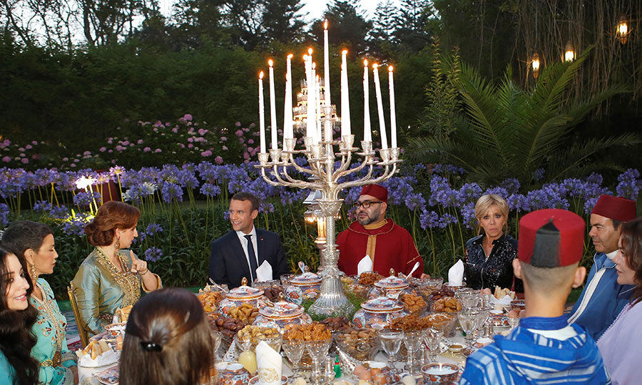 In the gardens at the Royal Palace in Rabat, (center, from left to right) Princess Lalla Salma, President Macron, King Mohammed VI and First Lady Brigitte attended an Iftar, the evening meal when Muslims end their daily Ramadan fast at sunset.