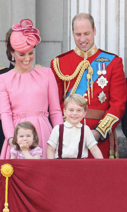 June 2017: The Cambridges took the balcony once again for the Queen's Trooping the Colour celebration. Princess Charlotte matched her mom in pink while George wore red suspenders that complemented his dad.
