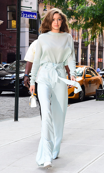 June 15: Gigi Hadid was spotted looking cool in New York City wearing a fresh Sally LaPointe ensemble. 