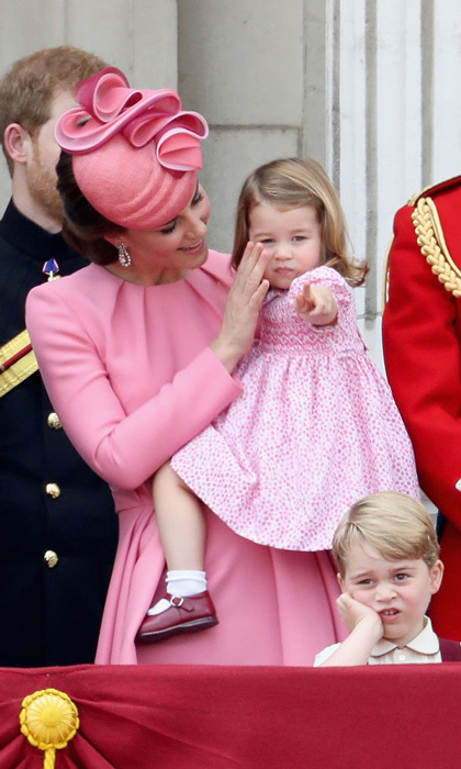 Duchess Kate gently grazed Charlotte's face as the two-year-old pointed toward the crowd during the Trooping the Colour festivities. 
