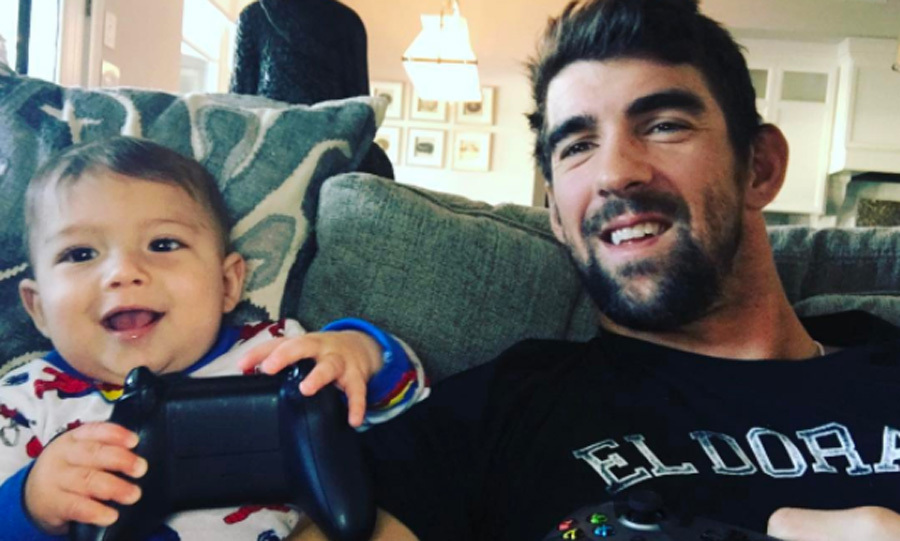 Two gamers! Michael let his son take the controls during an Xbox session.