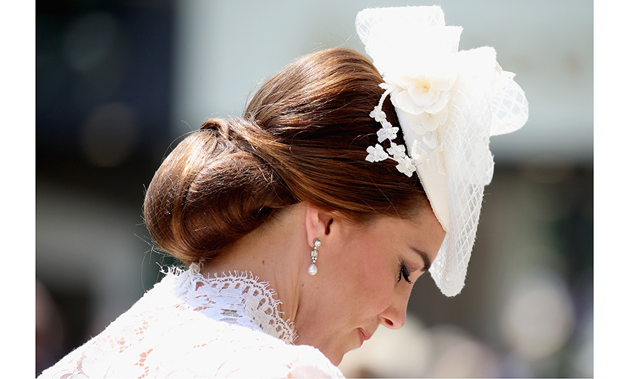 A close-up look at Duchess Kate's gorgeous hat and upswept chignon, held in place with her signature hairnet. 
