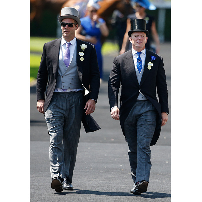 Former pro rugby player Mike Tindall, left – husband of Queen Elizabeth's granddaughter Zara – rocked a top hat and tails as he made his way through the venue with a friend.
