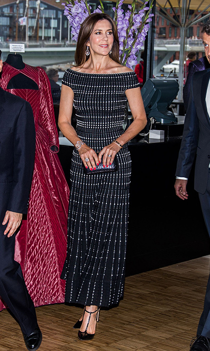 Crown Princess Mary wore a graphic motif dress for a concert at the Royal Playhouse with husband Crown Prince Frederik and Japan's Crown Prince Nahurito on June 16. 
