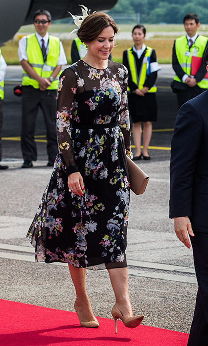 Danish Crown Princess Mary opted for dark florals to greet Japan's Crown Prince Nahurito at Copenhagen Airport on June 15.