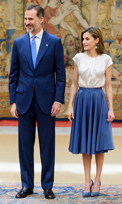 Queen Letizia of Spain, seen with husband King Felipe, looked sweet in a 1950s-style skirt and silk blouse to meet members of the Princesa de Asturias Foundation at El Pardo Royal Palace on June 16.