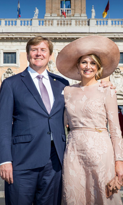 Queen Maxima brought her sophisticated style to Italy. The Dutch royal wore a blush dress with a wide-brimmed hat as she and her husband King Willem-Alexander arrived to Rome at Ciampino Airport. From there, the couple visited with Rome's mayor and kept on with their busy schedule.