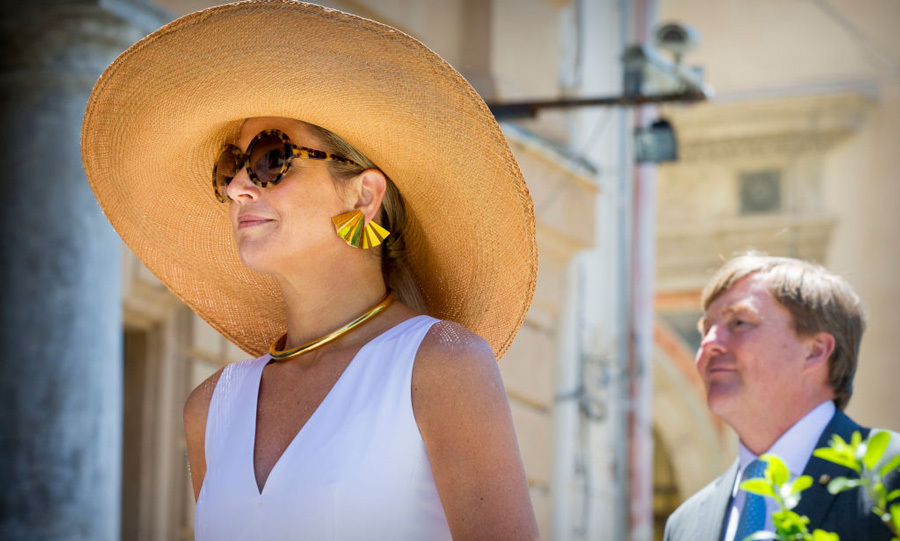 For their trip to Palermo, Queen Maxima beat the Sicilian heat in a straw-woven hat. The stylish royal added oversized shades and gold fan earrings for their visit with Leoluca Orlando at Quatto Canti.