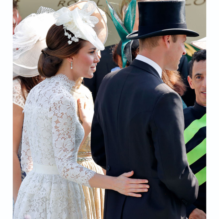 Kate placed her hand on the lower back of Prince William as they made their way through the crowd at the 2017 Royal Ascot.