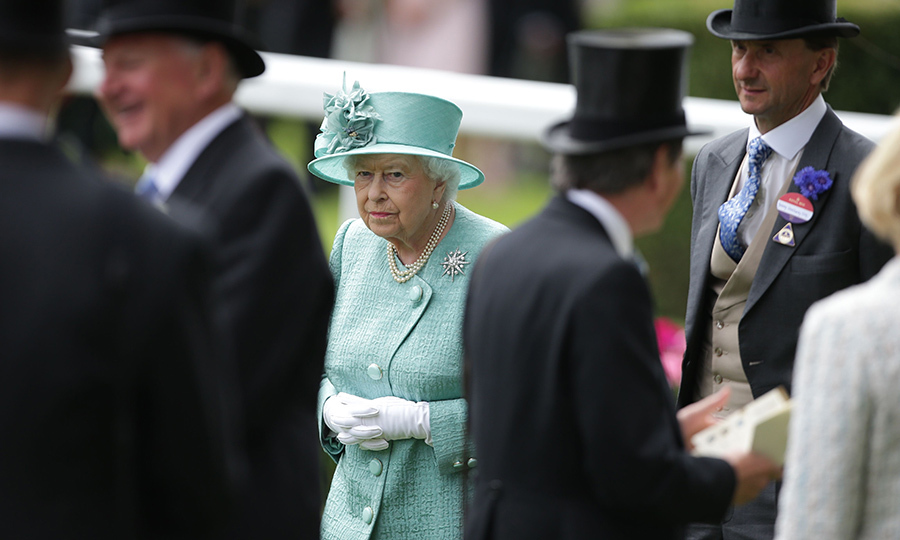 For Day Four, Queen Elizabeth opted for cool summer tones – and of course her signature gloves and pearls.