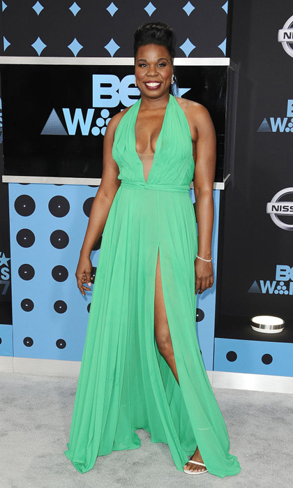 Leslie Jones took the plunge in a custom green gown by Stello for her hosting duty at the BET Awards.