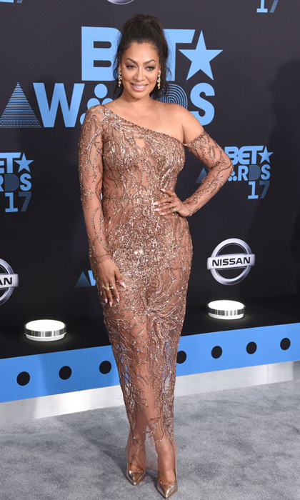 Lala Anthony wore a Thai Nguyen Atelier sheer dress with gold stilettos to the BET Awards.