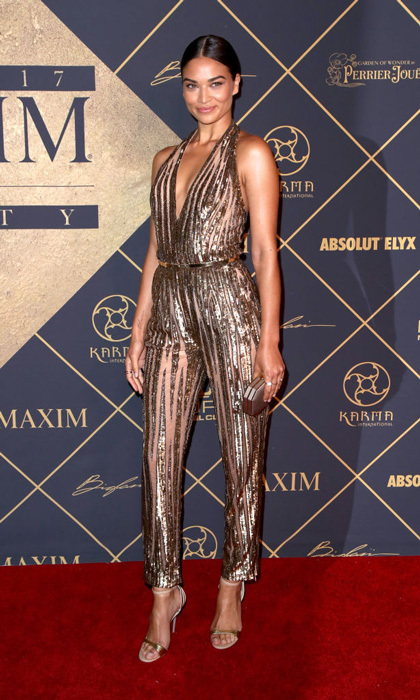 Shanina Shaik wore an Elie Saab jumpsuit with Balmain shoes to the Maxim 100 party at the Hollywood Palladium in L.A.