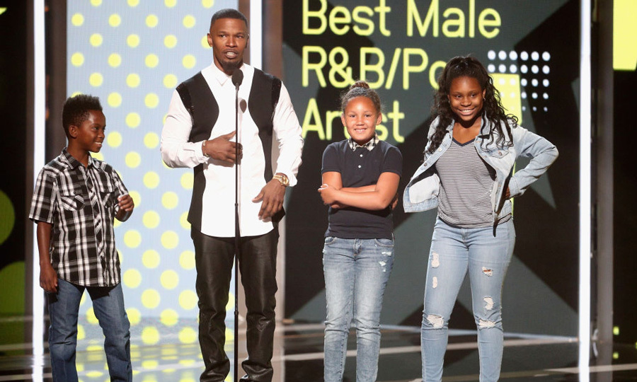 Jamie Foxx may have been presenting at the BET Awards, but we are sure he won for 'Best Dad' from his seven-year-old daughter Annalise and her friends as they joined him on stage.