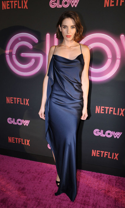 Allison Brie wore a satin navy gown to the <i>Glow</i> premiere in NYC.