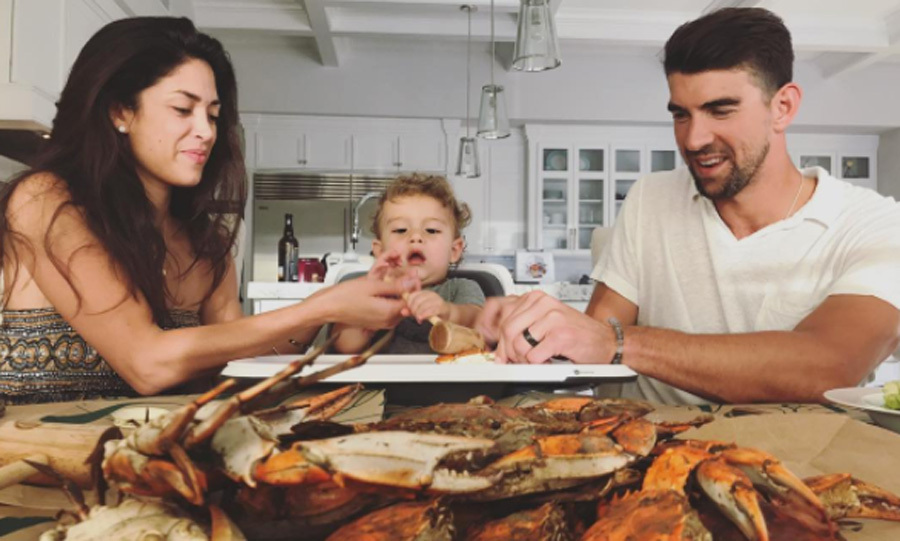 At just a year old, it looks like Boomer Phelps has quite the eclectic palate. Nicole shared a picture of herself, her husband, who hails from Maryland, and their son digging into crabs sent from Jimmy's Seafood in Baltimore.