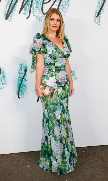 Royal cousin Lady Kitty Spencer had the perfect look for the Serpentine Galleries Summer Party in this Dolce & Gabbana long dress. The HELLO! Fashion Monthly cover star accessorized with a Bulgari clutch and kept her jewelry to a minimum.