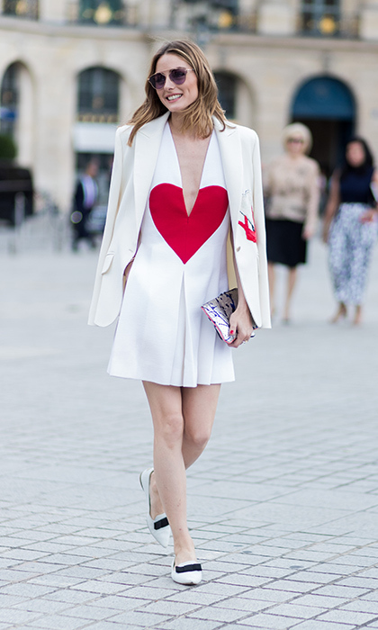 Olivia Palermo was wearing her heart on her sleeve – well, actually her dress! – outside the Schiaparelli show. 