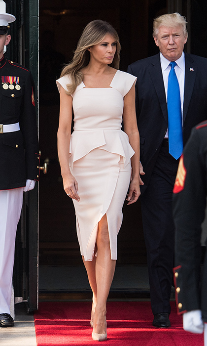 The first lady walked out of the White House out to help greet South Korean President Moon Jae-in wearing a signature peplum silhouette by Roland Mouret on June 29.