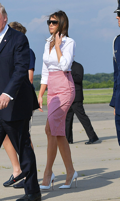 On June 30, the first lady looked all business in an Altuzarra pencil skirt and white blouse as she and her husband stepped off Air Force One upon arrival in Morristown, New Jersey.