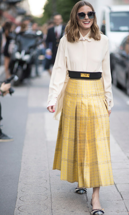 Olivia Palermo wore a pleated midi skirt to the Fendi presentation.