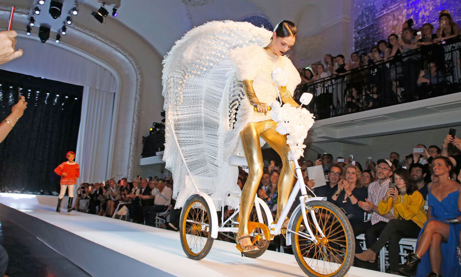 "Meanwhile that same day Coco also took the runway for  dear friend Jean Paul Gautier's show. ""BRIDE ON A BIKE! I've closed #JeanPaulGaultier's runway in a wheel barrow, on crutches, in a mermaid tail, on a swing and now... on a tricycle!! Lots of love to my friend and mentor @jpgaultierofficial on a tremendous show! So many pieces I can't wait to wear this year!"" she wrote on Instagram along with a photo of herself posing at the show.""