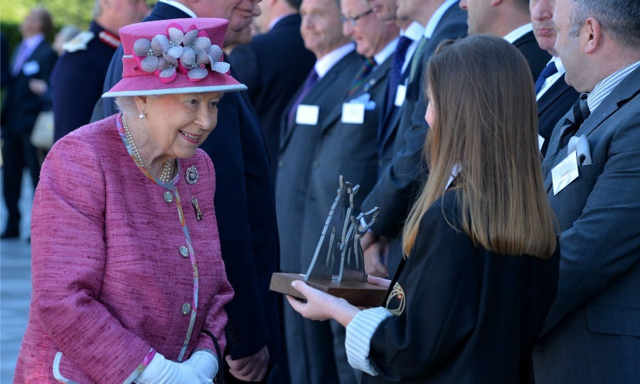 Queen Elizabeth never passes up a moment to match her hat to her ensemble during an appearance in Scotland.  
