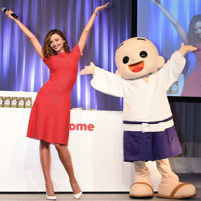 Hooray to healthy eating! Miranda Kerr had some fun during a promotional event for Marukome Organic Miso products in Tokyo on July 10. 