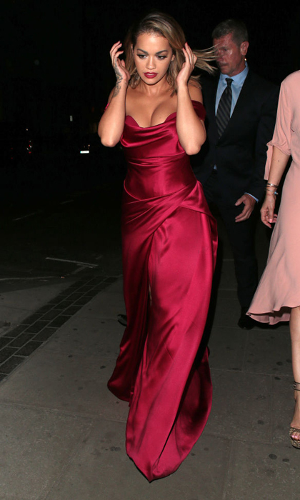 Rita Ora wore a crimson satin dress to the Cartier Dinner at Freemason Hall in London on July 6.