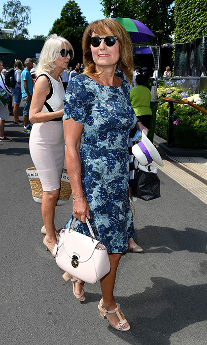 Kate Middleton's mom Carole stepped out in a printed dress and block-heeled sandals.
