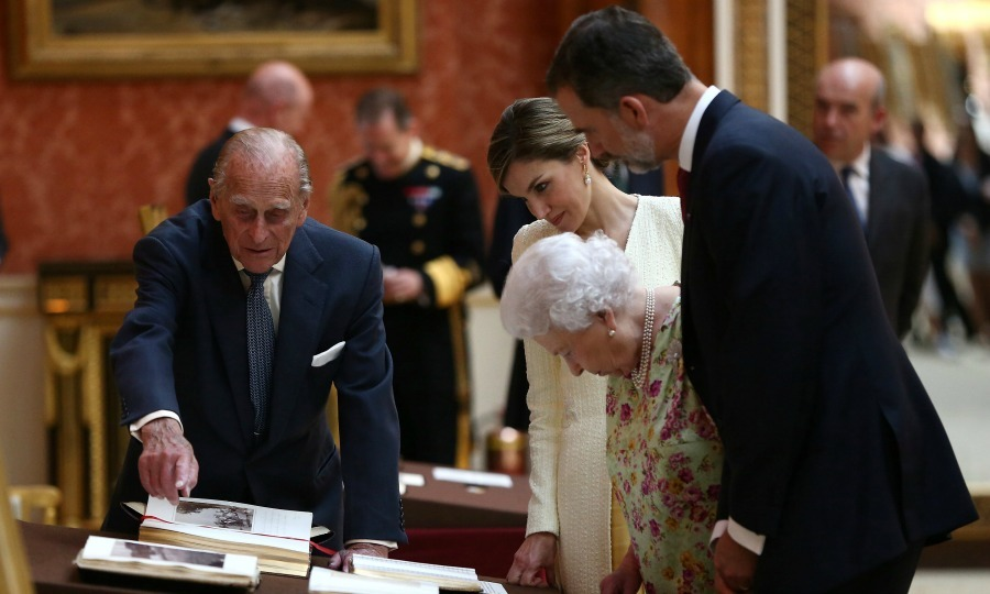 After lunch, Felipe and Letizia accompanied the British royal family for the viewing of Spanish items on display as part of the Royal Collection. Once inside, Prince Philip showed off some of his favorite pieces from the collection. 