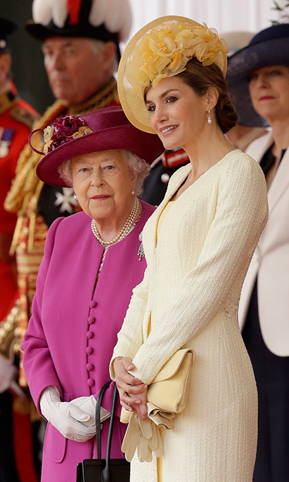 Queen Elizabeth and Queen Letizia chatted while taking their places in front of Buckingham Palace, ahead of a private lunch hosted by the British Monarch's family.