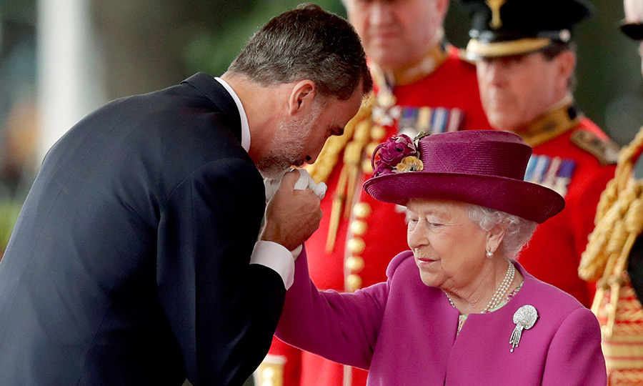 King Felipe kissed the Queen's hand during the event.