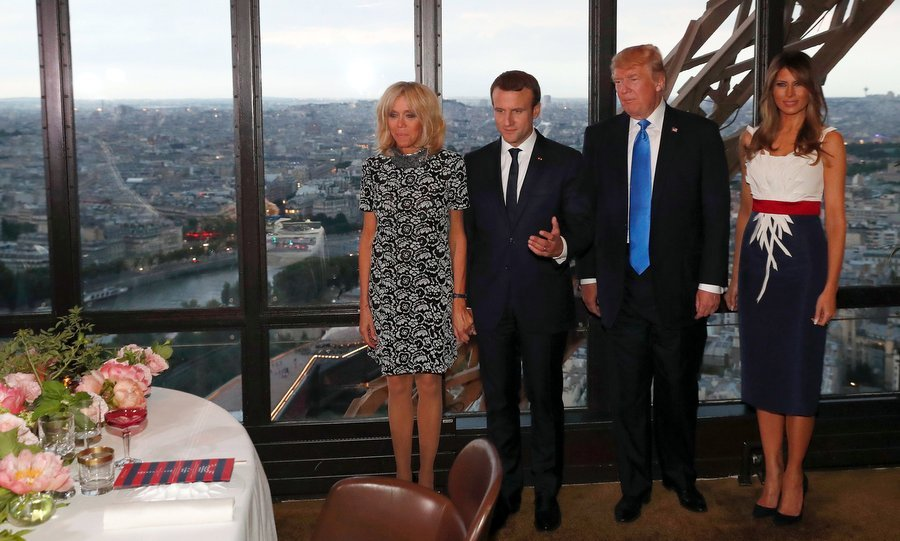 For a July 13 dinner at at Le Jules Verne Restaurant at the Eiffel Tower with husband Donald Trump, French President Emmanuel Macron and his wife Brigitte Macron, Melania donned a red white and blue dress by Herve Pierre, who designed her Inaugural Ball gown.