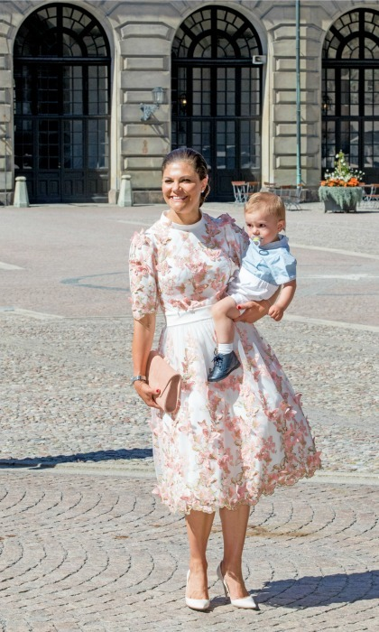 Crown Princess Victoria was a stand out in a pink dress as she held on to her son Prince Oscar during her 40th birthday celebration at the royal palace in Stockholm, Sweden.