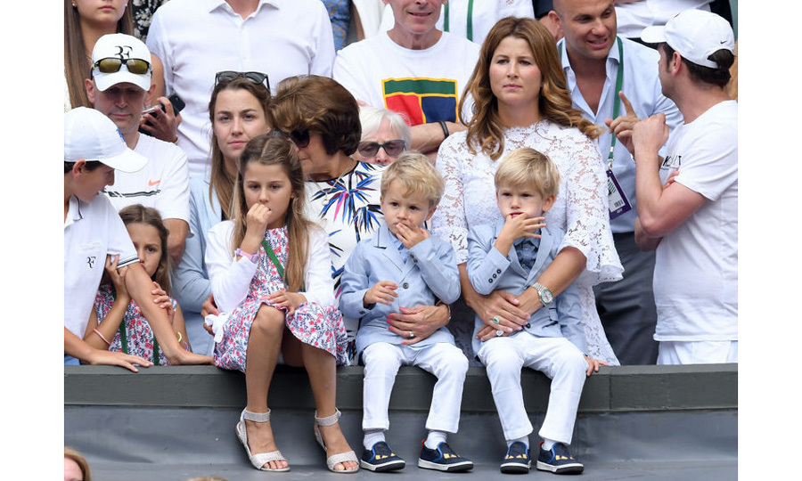 Mirka Federer held on to one of her and Roger's sons along with the rest of their children as he won his eighth title.
