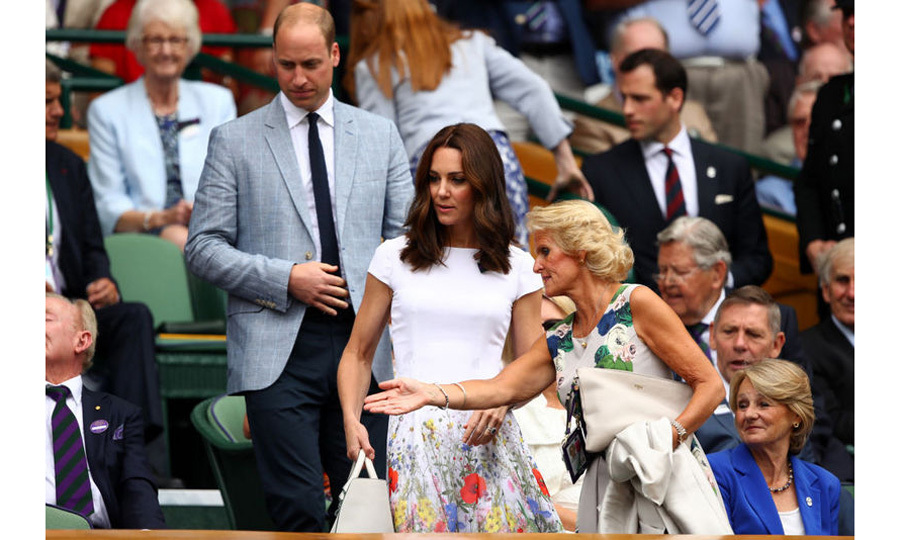 For the final day of Wimbledon 2017, the Duchess watched Roger Federer and Marin Cilic in a Catherine Walker white dress with flower details. She accessorized with a white hand bag and her hair in a simple wave.