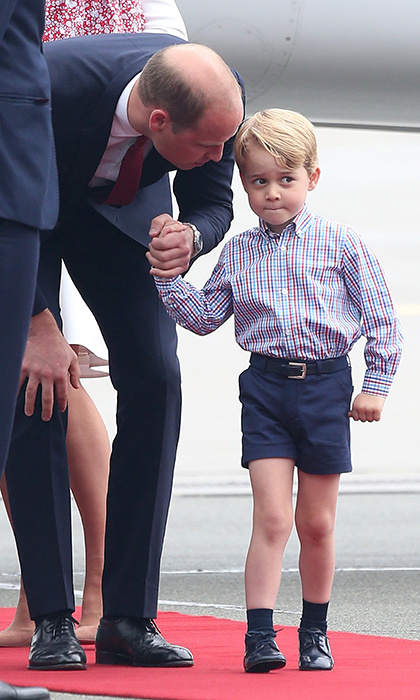 The adorable little prince finally made his way out of the aircraft, holding tight onto his father's hand.
