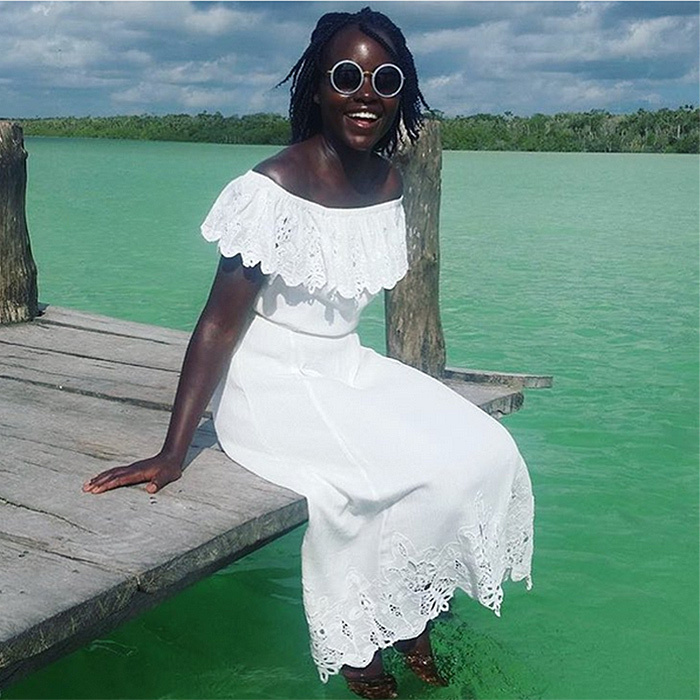 Lupita Nyong'o's cool vacation backdrop was only matched by her ultra-cool off-the-shoulder dress by Rachel Zoe. The Oscar-winning star is spending some time enjoying the Riviera Maya in Mexico – the country where she was born.