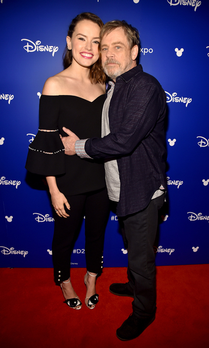 The force is strong with these two! Mark Hamill hugged his <i>Star Wars: The Last Jedi</i> co-star Daisy Ridley during Disney's D23 EXPO 2017 on July 15.
