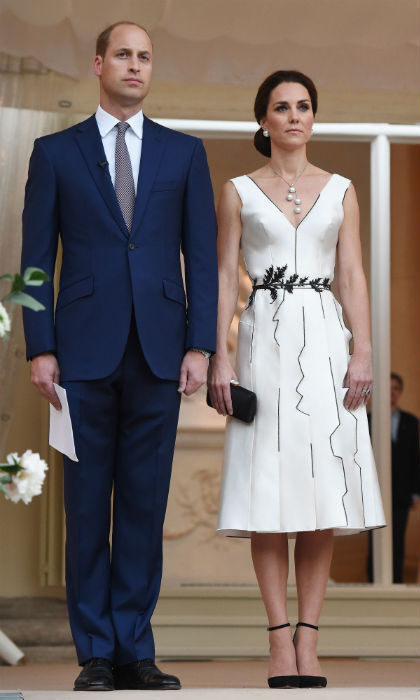 As a nod to the host country, the Duchess chose a white dress by Polish designer Gosia Baczynska for a dinner party in Warsaw, accessorizing with Balenciaga 'Eugenia' faux pearl earrings and a pearl drop necklace.