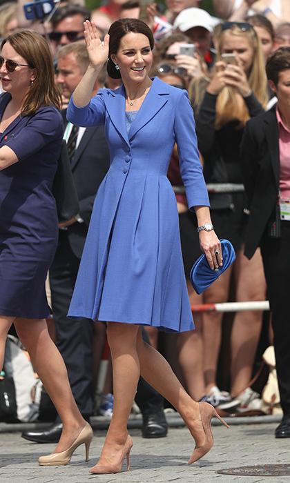 Earlier, the Duchess of Cambridge had kicked off the third day of the tour in her trusty Gianvito Rossi shoes, a tailored blue coatdress by Catherine Walker – a Princess Diana favorite – and a new Jimmy Choo 'Vivienne' clutch. Kate chose a cornflower blue ensemble in honor of Germany's national bloom.