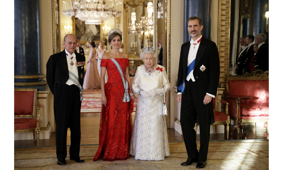 Queen Letizia alongside Queen Elizabeth and their respective husbands, Prince Philip (left) and King Felipe (right) at a state banquet dinner held at Buckingham Palace in honor of the Spanish monarchs' visit to the UK.