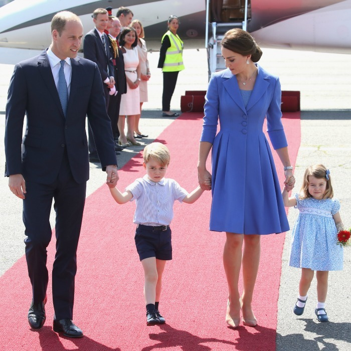 The royals looked picture perfect as they held hands wearing their coordinated cornflower blue outfits to match the color of one of Germany's national flowers, the blue cornflower.
