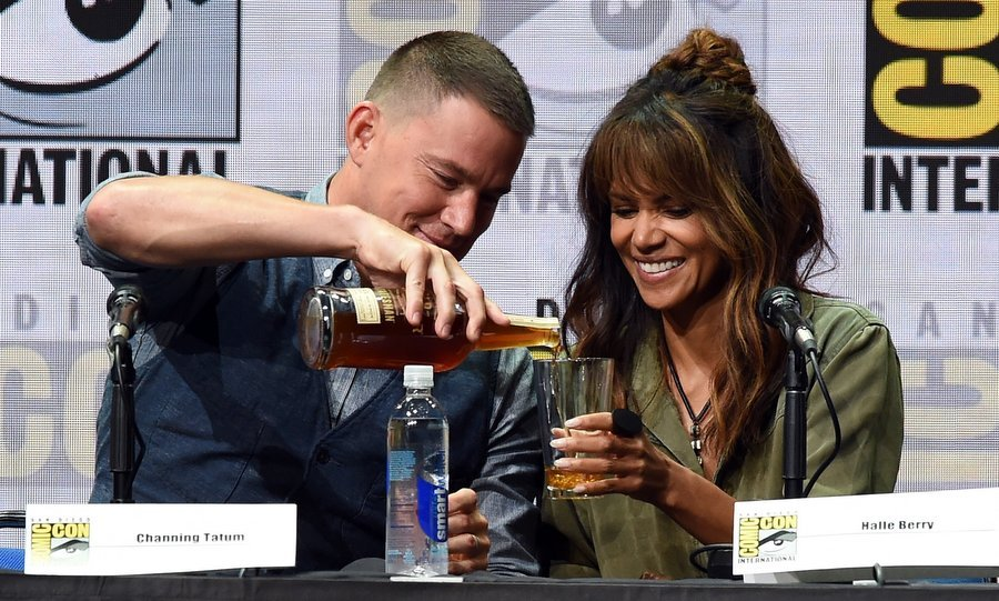 We'll drink to that! Channing Tatum poured Halle Berry a tall one at the 20th Century FOX panel during Comic-Con International 2017 at the San Diego Convention Center on July 20.