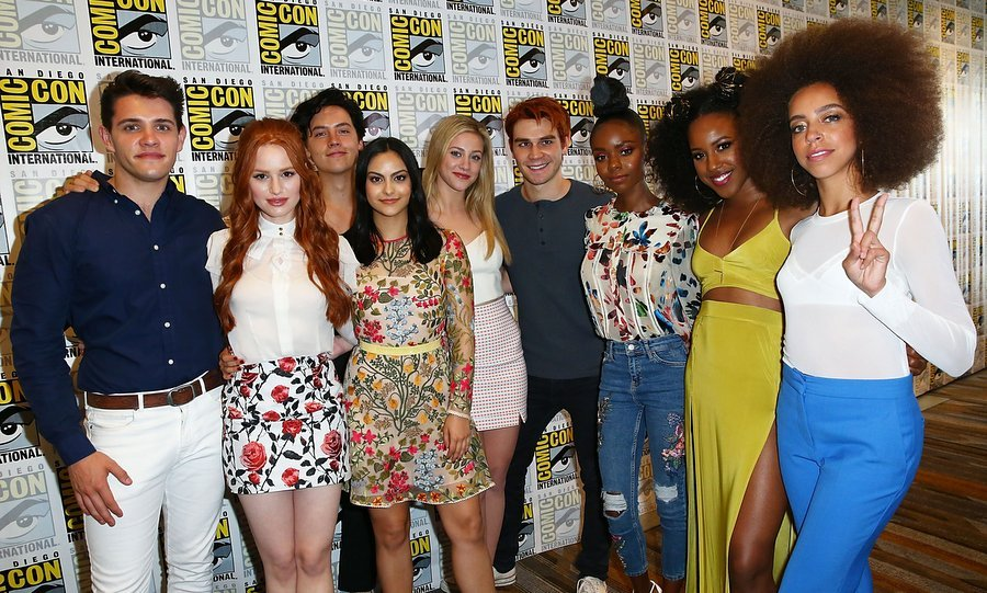 Fans of <I>Riverdale</I> were thrilled to see the ensemble cast at this year's Comic-Con. From left to right, Casey Cott, Madelaine Petsch, Cole Sprouse, Camila Mendes, Lili Reinhart, KJ Apa, Ashleigh Murray, Asha Bromfield and Hayley Law.