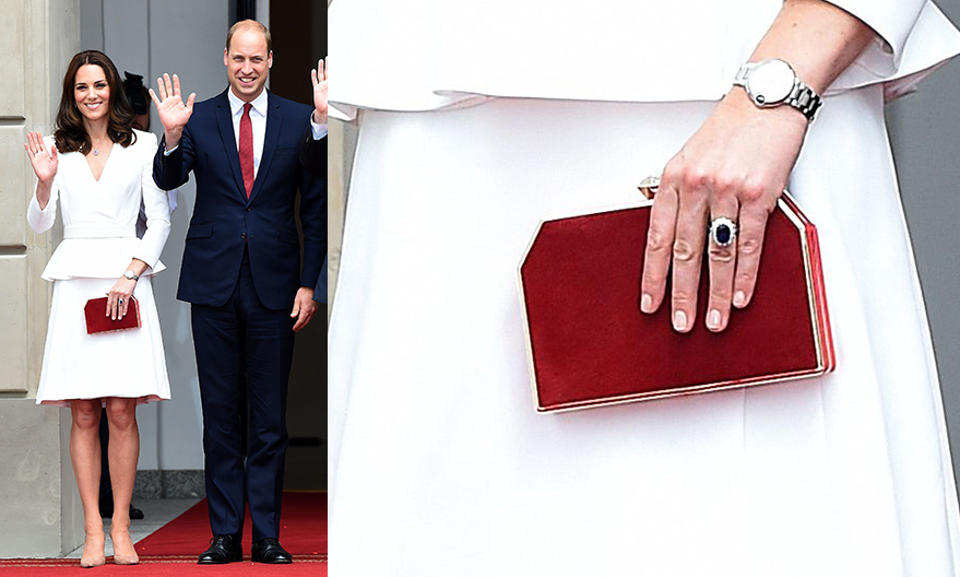 To begin a five-day tour of Germany and Poland in July 2017, the Duchess of Cambridge accessorized her Alexander McQueen peplum skirt suit with a red <b>Jenny Packham</B> 'Casa' clutch.