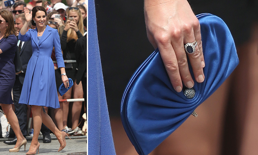 In Germany, Kate wore a tailored blue coatdress by Catherine Walker and carried a new <b>Jimmy Choo</B> 'Vivienne' bag.