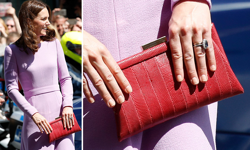 The Duchess went for a bold color block choice – a red <b>Anya Hindmarch</B> snakeskin clutch to contrast with her lavender Emilia Wickstead dress – for her last day in Germany.